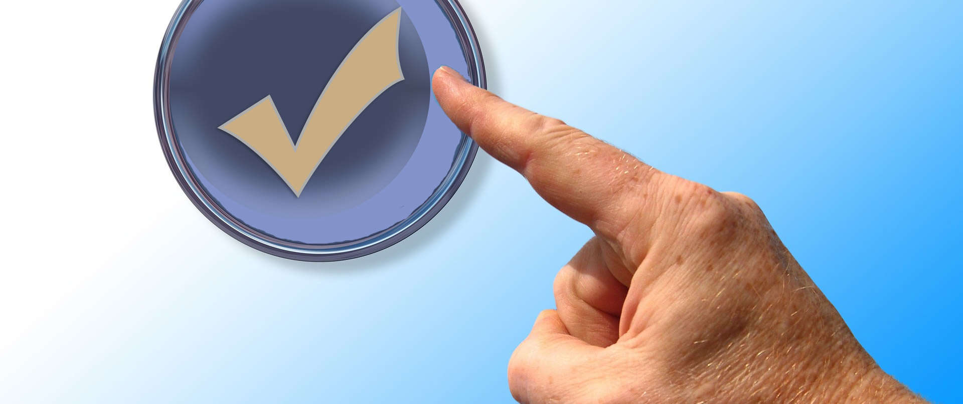 hand pointing at a round checkmark button